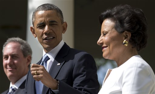 President Barack Obama looks to longtime fundraiser and philanthropist Penny Pritzker, right, in the Rose Garden of the White House on Thursday, where he announced that he will nominate Pritzker to run the Commerce Department and economic adviser Michael Froman, left, as the next U.S. Trade Representative.
