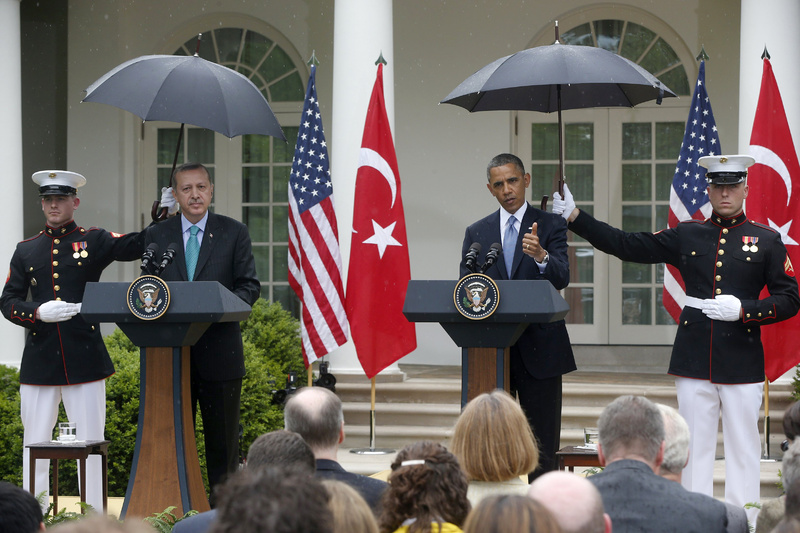 Marines hold umbrellas as President Obama and Turkish Prime Minister Recep Tayyip Erdogan participate in a joint news conference in the Rose Garden of the White House in Washington on Thursday.