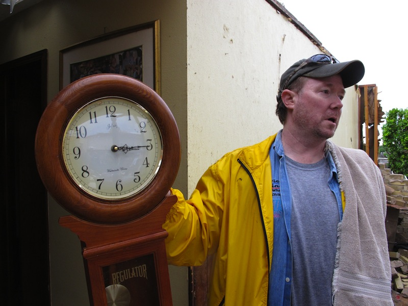 Kevin Metz shows holds up a stopped clock he found in the rubble of his father's home in Moore, Okla., on Tuesday, May 21, 2013. Monday's EF5 tornado destroyed Wayne Osmus' home and much of the Oklahoma City suburb. (AP Photo/Allen Breed)