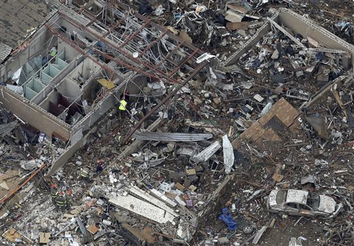 An aerial view shows Tower Plazas Elementary school in Moore, Okla., on Tuesday as rescue workers make their way through the structure. At least 24 people, including nine children, were killed in the massive tornado that flattened homes and a school in Moore.