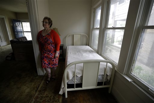 Patricia Hall stands in the 5-by-14 room that Lee Harvey Oswald rented in1963 at her family's boarding house in Dallas.