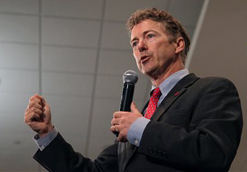 Sen. Rand Paul, R-Ky., speaks at the Iowa GOP Lincoln Dinner event Friday in Cedar Rapids, Iowa. Paul wrote an opinion piece in The Washington Times restating his view that President Obama should have fired then-Secretary of State Hillary Rodham Clinton after the terrorist attack on the U.S. diplomatic compound in Benghazi.