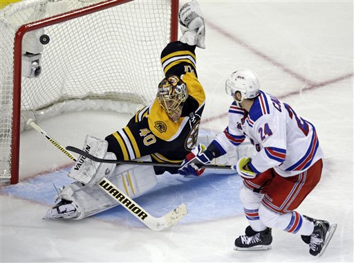 Boston Bruins goalie Tuukka Rask makes a save on a breakaway by New York Rangers right wing Ryan Callahan Saturday during the third period in Game 5 of the Eastern Conference semifinals in the NHL hockey Stanley Cup playoffs in Boston.