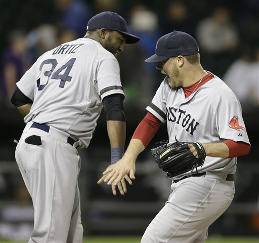 Boston Red Sox closer Andrew Bailey, right, celebrates with teammate David Ortiz after defeatingthe Chicago White Sox 6-2 in a baseball game in Chicago, Wednesday, May 22, 2013. (AP Photo/Nam Y. Huh)