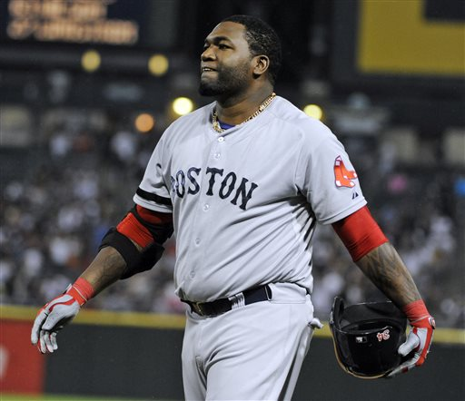 Boston Red Sox designated hitter David Ortiz reacts after hitting into a double play against the Chicago White Sox during the eighth inning of a baseball game,Tuesday, May 21, 2013 in Chicago. (AP Photo/David Banks)