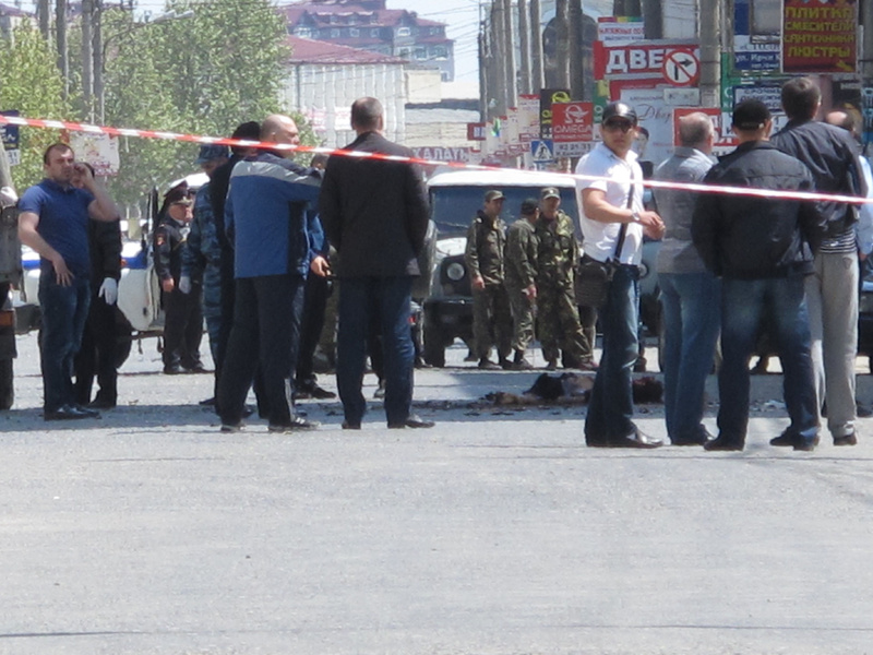 Police and forensic experts examine the site of an explosion in downtown Makhachkala, Dagestan on Wednesday. Russian police say a bomb exploded in a busy shopping area in the capital of the restive republic of Dagestan, killing at least two people. Dagestan is plagued by Islamic insurgents who frequently mount small attacks on police.