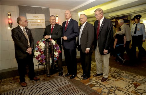 From left, U.S. Congressmen, Steve Cohen, D-Tenn., Dana Rohrabacher, R-Calif., Bill Keating, D-Mass., Steve King, R-Iowa, and Paul Cook, R-Calif., lay a wreath at the site of a terrorist attack in 2000 in the underground street passage in Pushkin Square in downtown Moscow on Wednesday.
