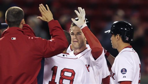 Boston Red Sox shortstop Stephen Drew is congratulated by teammates after his game-winning, RBI double in the eleventh inning of a baseball game against the Minnesota Twins at Fenway Park in Boston, Monday, May 6, 2013. The Red Sox won 6-5. (AP Photo/Charles Krupa)
