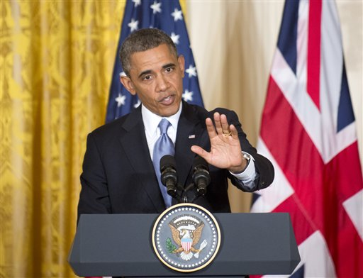 President Barack Obama gestures during a joint news conference with British Prime Minister David Cameron on Monday, in the East Room of the White House in Washington.