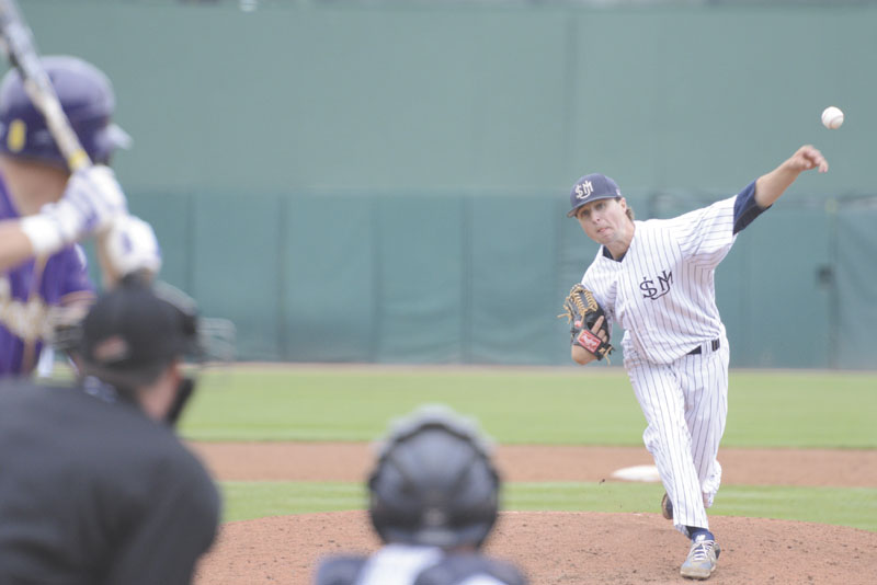 STILL ALIVE: Tyler Leavitt delivers a pitch during the ninth inning of University of Southern Maine's 8-1 wn over the University of Wisconsin Stevens Point during the Division III College Baseball World Series on Monday at in Appleton, Wis.