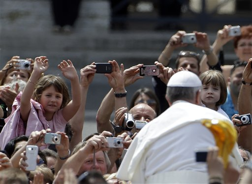 Pope Francis greets the faithful at the end of a canonization Mass in St. Peter's Square at the Vatican Sunday. The pontiff canonized Antonio Primaldo and his companions, also known as the Martyrs of Otranto; Laura di Santa Caterina da Siena Montoya of Colombia; and Maria Guadalupe Garcia Zavala of Mexico.
