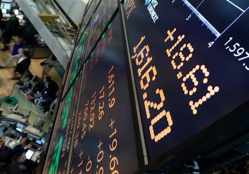 A board overlooking the floor of the New York Stock Exchange shows an intraday number above 1,600 for the S&P 500 on Friday.