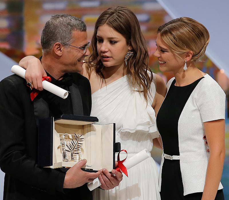 """Director Abdellatif Kechiche and actors Adele Exarchopoulos and Lea Seydoux react after they receive the Palme d'Or award for """"Blue Is the Warmest Color: The Life of Adele"""" at the awards ceremony at the 66th international film festival, in Cannes, southern France on Sunday."""