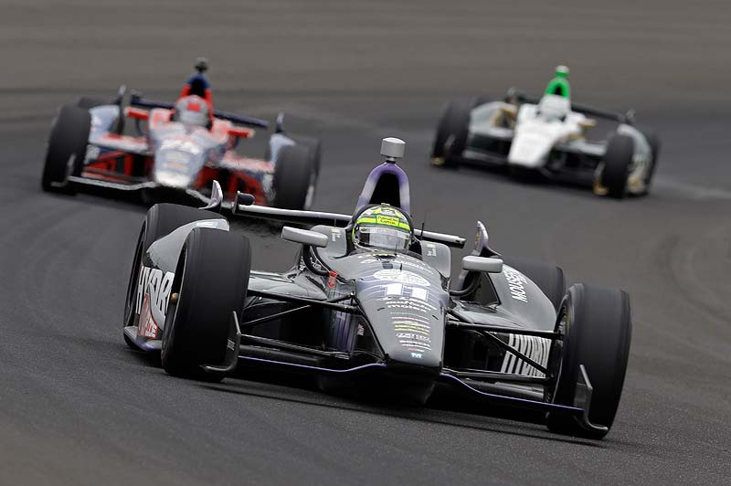 Tony Kanaan of Brazil drives through the first turn Sunday in the Indianapolis 500 on Sunday.