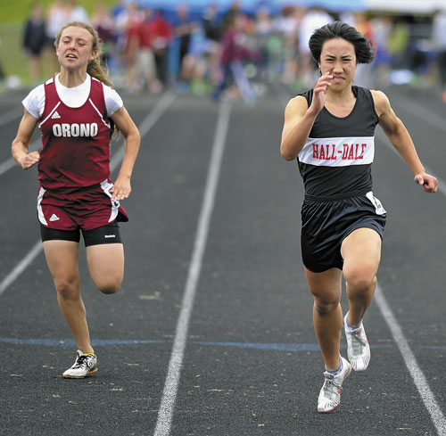 GETTING BETTER: Former Hall-Dale High School star Bri Crisci, right runs to victory in the 100-meter dash at the Class C state championship track and field meet last season. Crisci is finding a niche in middle distance events while running for Belmont Abbey College.