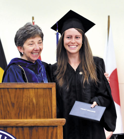 MADE IT: Colby College graduate Brittney Bell of Poland smiles after receiving her diploma from Lori Kletzer, vice president of Academic Affairs and Dean of Faculty, on Sunday afternoon. Bell could not make it back for Sunday morning's commencement as she was in Wisconsin competing in the NCAA Division III track and field championships on Saturday night.