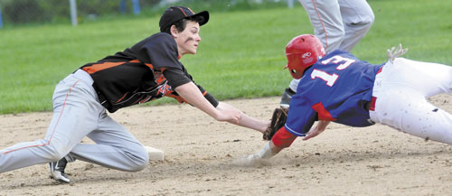 MAKE THE TAG: Skowhegan's Derek McCarty tags out Messalonskee's Ben Frazee at second base during the Eagles' 11-3 win on Monday in Skowhegan.