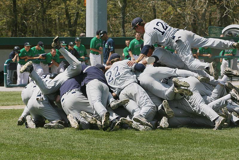 The University of Southern Maine celebrates their 9-0 victory over Endicott College Sunday in the championship game of the NCAA Division III New England Regional in Harwich, Mass.