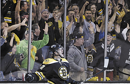 GOAL: Fans cheer as Boston Bruins defenseman Torey Krug celebrates his goal against the New York Rangers during the first period in Game 2 of the Eastern Conference semifinals Sunday in Boston.