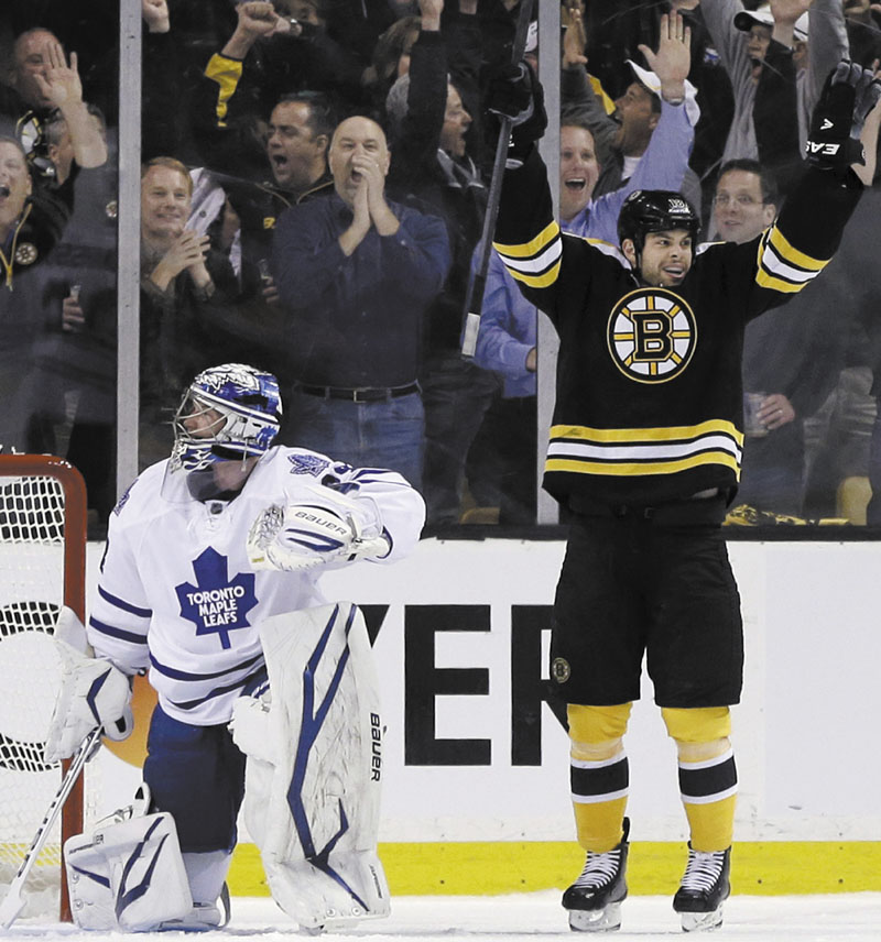 ALL RIGHT: Boston right wing Nathan Horton, right, celebrates his goal in the first period against Toronto goalie James Reimer during Game 1 of their first-round playoff series Wednesday in Boston. TD Garden