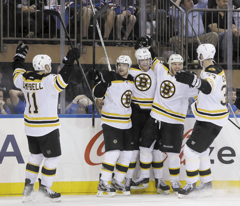 BIG GOAL, BIG WIN: Boston's Daniel Paille, second from left, celebrates his game-winning goal with teammates Gregory Campbell, left, Dougie Hamilton, center, Shawn Thornton, second from right, and Zdeno Chara during the third period of Game 3 of the Eastern Conference semifinals against the New York Rangers on Tuesday in New York. The Bruins won 2-1 and lead the best-of-seven series 3-0.