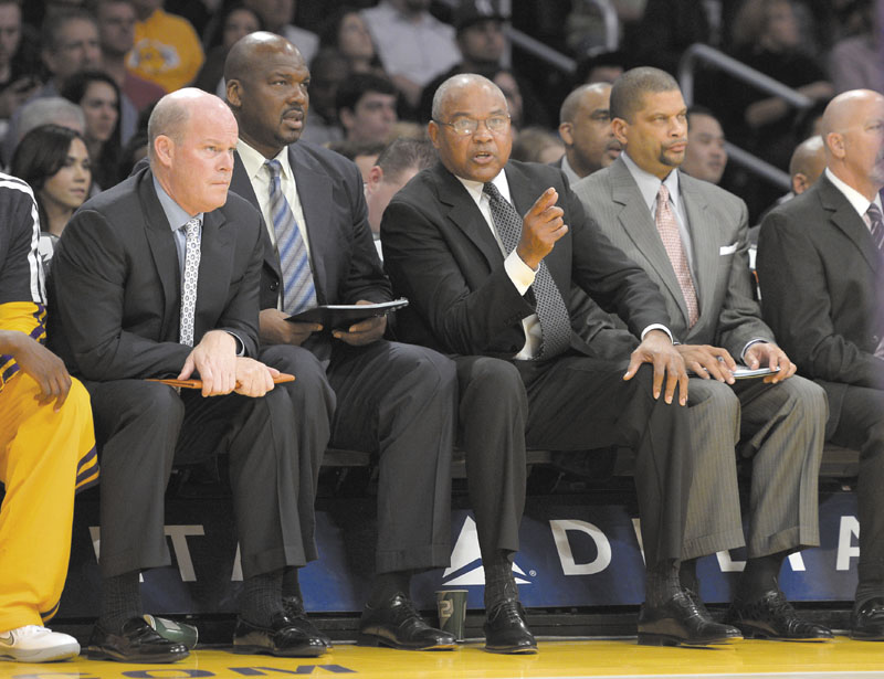 LANDING A HEAD JOB: University of Maine at Farmington graduate Steve Clifford, left, was introduced Wednesday at the Charlotte Bobcats head coach. Clifford graduated from UMF in 1983.
