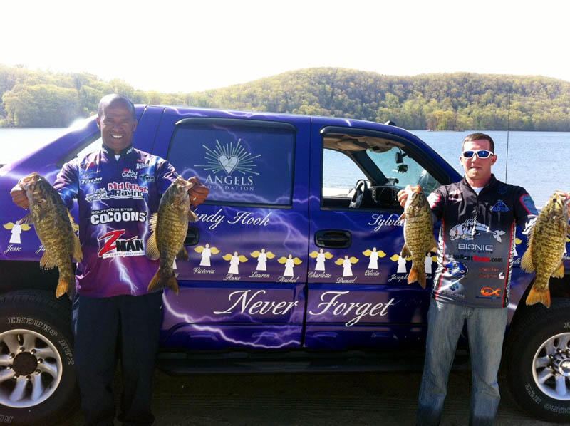 Troy Garrison, of Topsham, left, and Corey Vose, of Augusta, right, competed in the 26 Angels Foundation bass fishing tournament on May 5 at Candlewood Lake in Connecticut. The professional fishermen competed in the tournament in Garrison's custom-designed bass boat and matching truck, which are covered with the 26 Angels symbol, the names of the 26 Sandy Hook Elementary School massacre victims, and an angel for each person lost. Garrison said he decided to have his gear customized as a tribute to the victims of the mass shooting at Newtown, Conn. on Dec. 14.