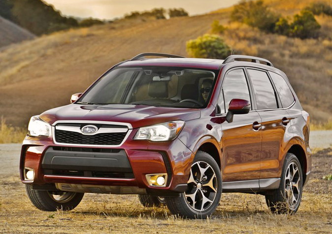 """The 2014 Subaru Forester, shown here, and Mitsubishi Outlander Sport each received the """"Top Safety Pick Plus"""" award because they performed well in multiple tests including the small offset crash."""