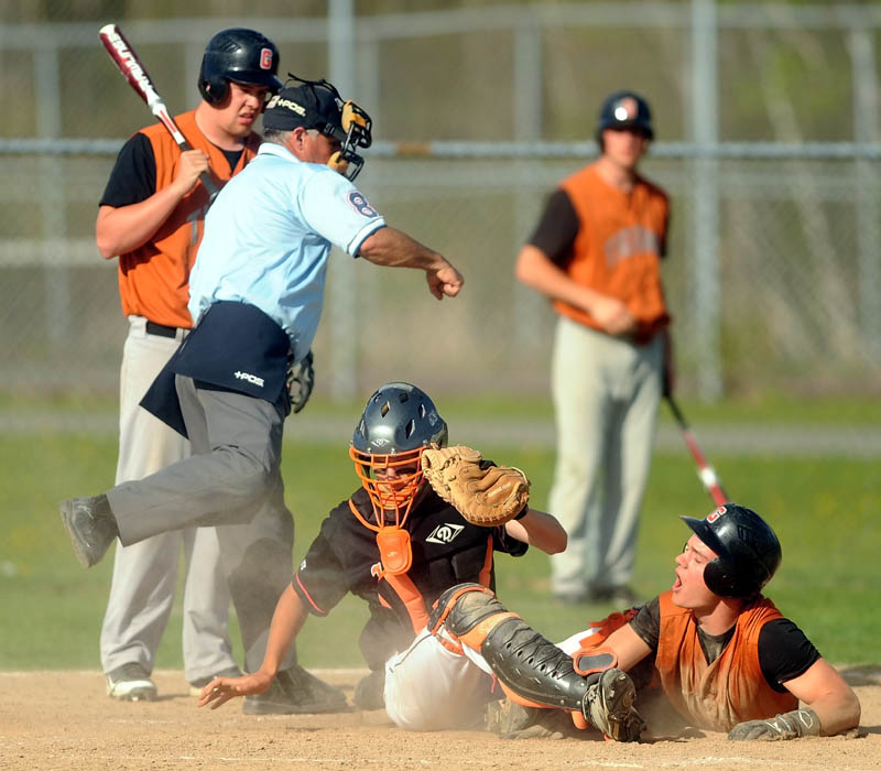 Winslow High School catcher Bobby Chenard,4, tags out Gardiner High School's Frank Chepke, 11, on a home plate steal attempt in the bottom of the fifth inning at Winslow High School Wednesday. Winslow defeated Gardiner 1-0.