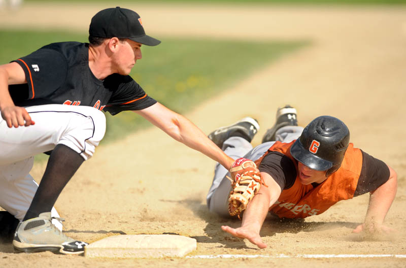 MAKING THE TAG: Winslow High School first baseman Logan Hewes, left, tags out Gardiner High School's Dennis Meehan,2, on a pick-off play from Winslow pitcher Donald Camp Wednesday at Winslow High School. Winslow defeated Gardiner 1-0.