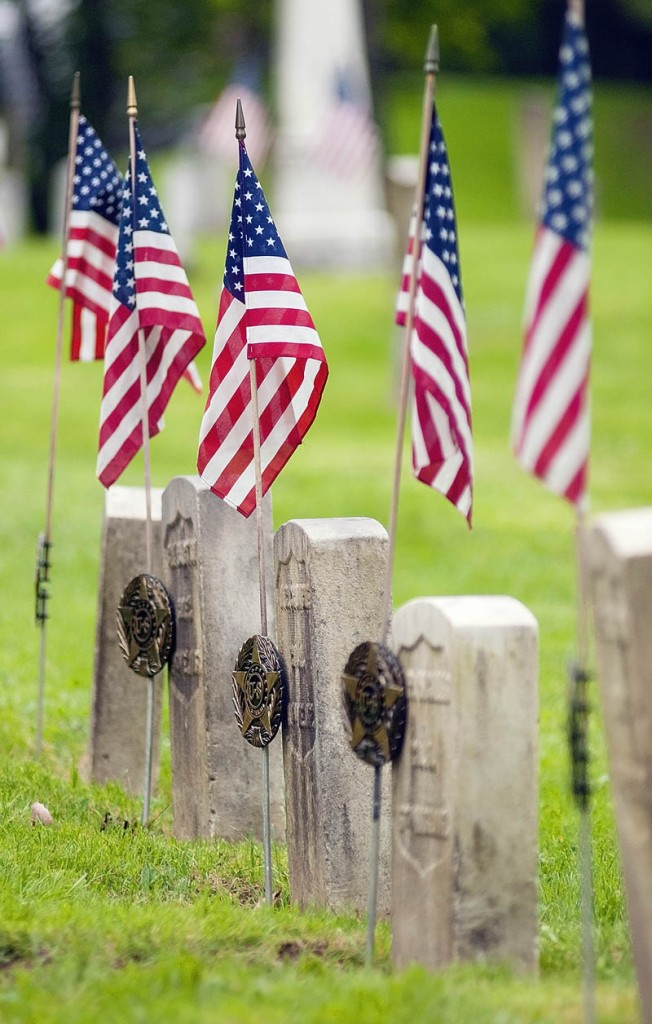 American flags fly over the graves of Civil War soldiers on Friday in Chelsea's Riverside Cemetery.
