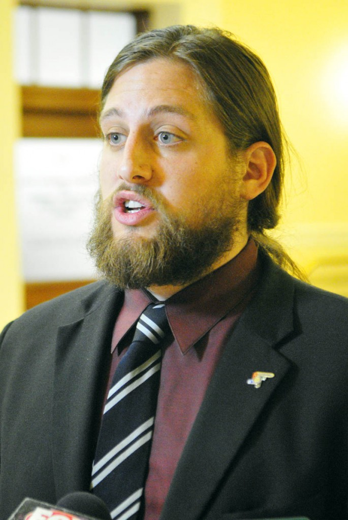 Paul T. McCarrier, legislative liaison for the Medical Marijuana Caregivers of Maine, talks to reporters on Friday at the State House in Augusta. He was there to testify against L.D. 1229, An Act To Regulate and Tax Marijuana.