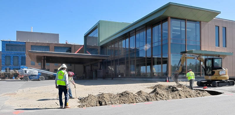 Construction workers can be seen near the entrance of the new MaineGeneral Medical Center regional hospital in Augusta last week.