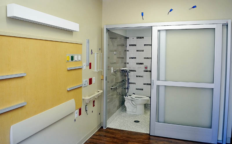 This photo, taken during a tour on Tuesday, shows that patient rooms at the new MaineGeneral regional hospital in North Augusta feature sliding doors on the bathrooms .