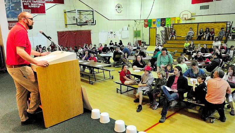 Principal Joshua McNaughton gives opening remarks during the Education Celebration on Friday at Whitefield Elementary School. There were activities for parents and students in each of the classrooms, along with a dinner. The school's parent-teacher association held a silent auction as a fundraiser for new playground equipment at the school.