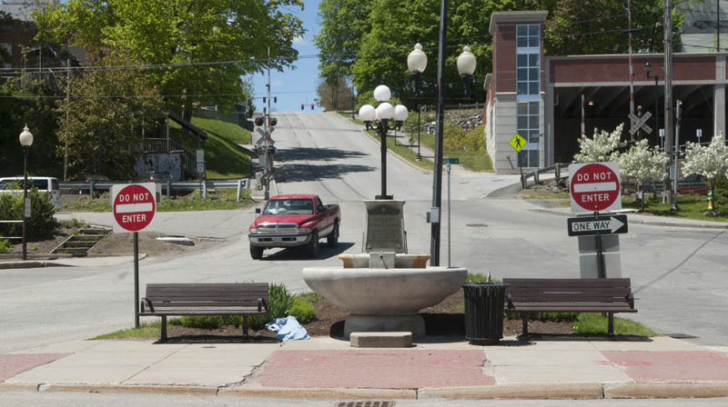 This photo taken on Friday shows the historic Baker fountain at the intersection of Winthrop and Water streets. Proposed renovations to Market Square would move the fountain to the area where the current Kennebec Explorer bus stop is located.