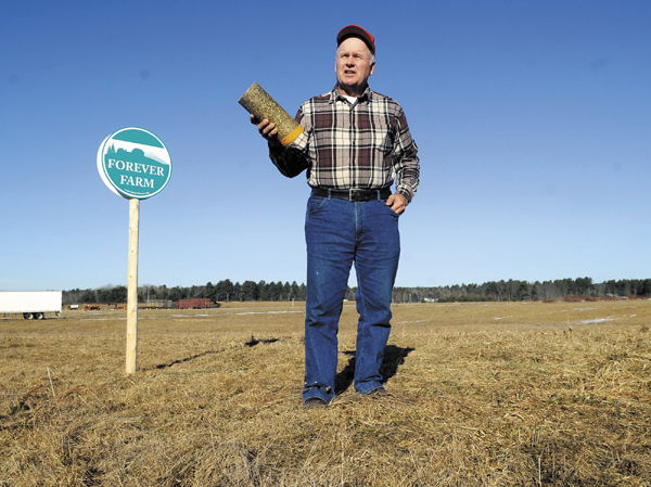 Vassalboro farmer Peter Bragdon hopes to preserve farmland by producing logs from hay for home-heating use.