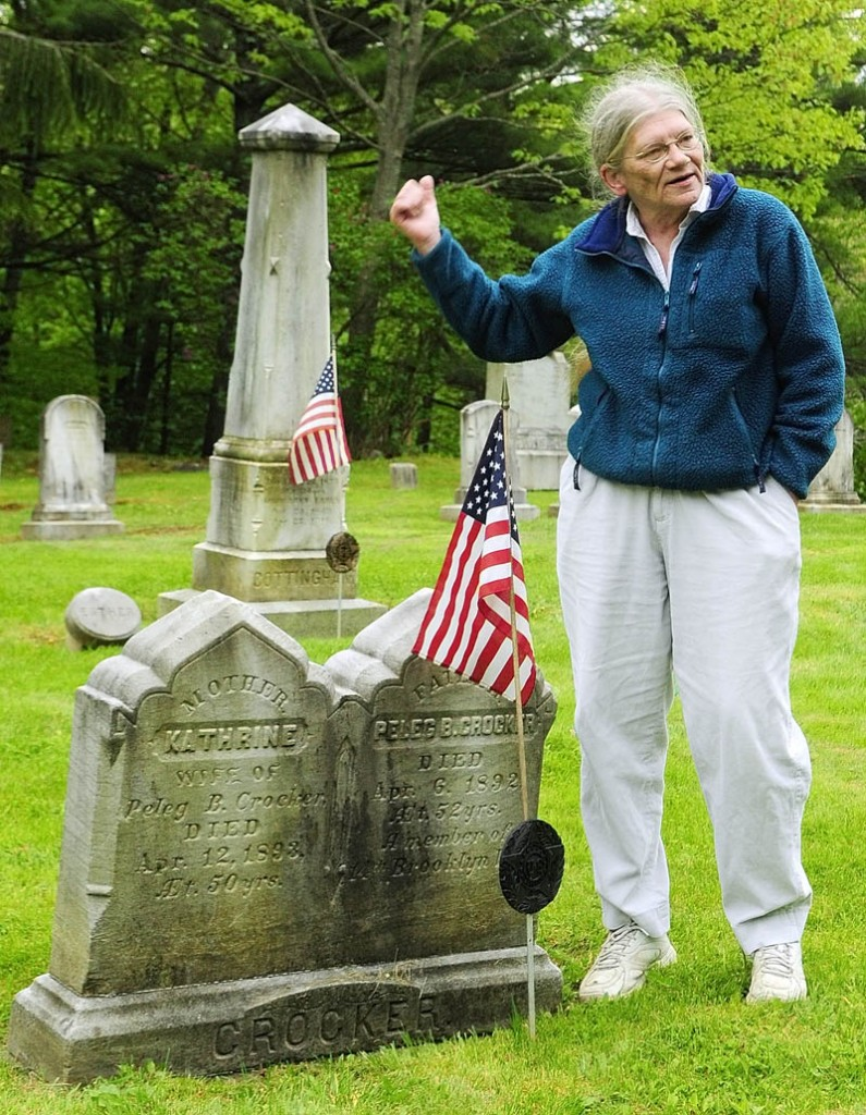 Standing beside the graves of Civil War Veteran Peleg Crocker and his wife, Katharine, Libby Doak talks about the him and many other soldiers buried nearby during an interview on Friday in Chelsea's Riverside Cemetery.