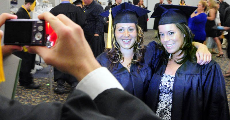 Robin Brady, of Pembroke, left, and Stephanie Escude, of Waterville, poses for a snapshot before the Kennebec Valley Community College commencement on Saturday at the Augusta Civic Center.