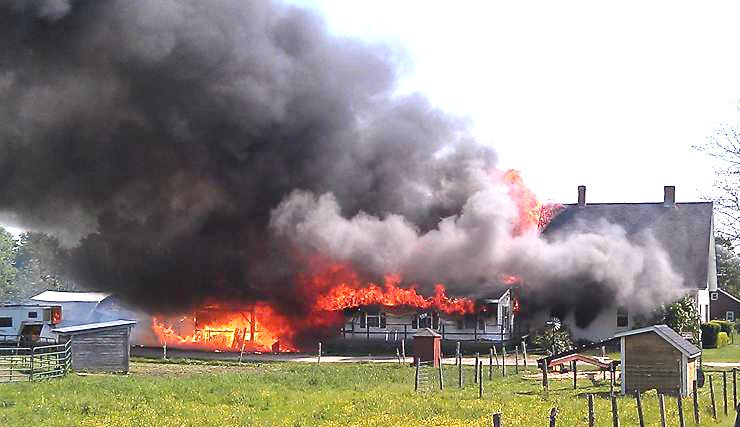 Fire consumed a farmhouse and barn on Hallowell-Litchfield Road in Litchfield on Friday.