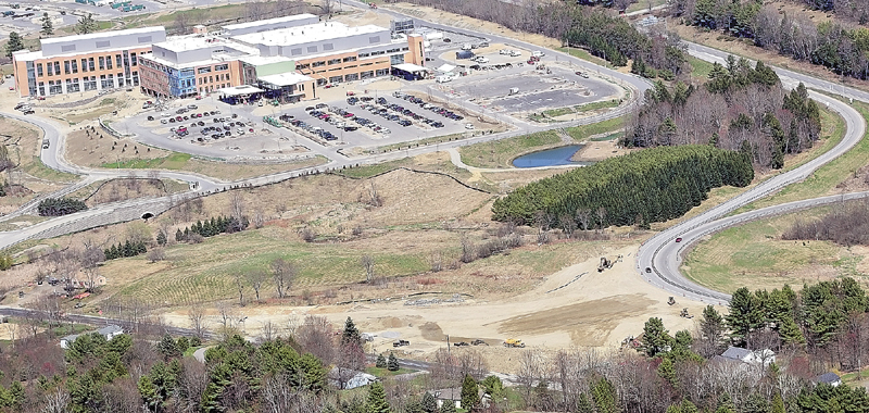 This aerial photo taken on Tuesday shows road construction between Old Belgrade Road, bottom, and exit ramps for Interstate 95 Exit 113 and the new MaineGeneral regional hospital being built in Augusta.