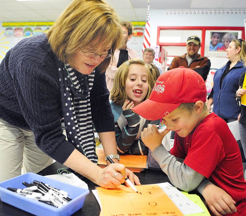 Teacher Kelly Peavey, left, plays a word game with Bella Bodmer, center, and Chase Peaslee during the Education Celebration on Friday at Whitefield Elementary School.