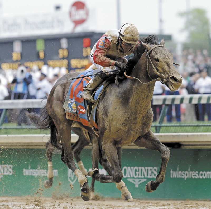 MAKING THEIR MOVE: Joel Rosario rides Orb to the win Saturday at the 139th Kentucky Derby at Churchill Downs in Louisville, Ky.