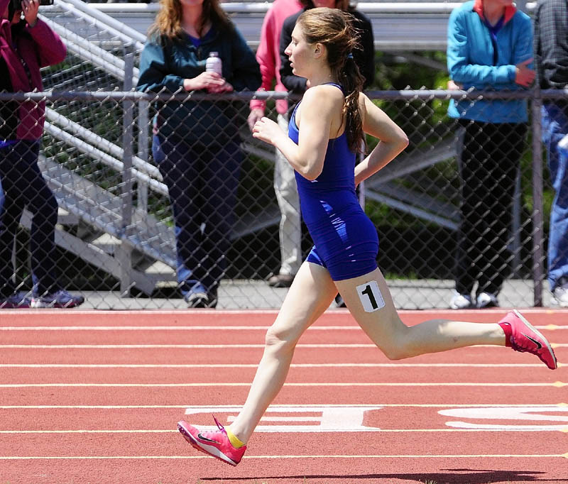 STELLAR DAY: Erzsie Nagy won the 800-, 1,600- and 3,200-meter runs and also ran on the winning 4x800 relay team as the Lawrence girls won the Kennebec Valley Athletic Conference Class A title Monday in Bath.