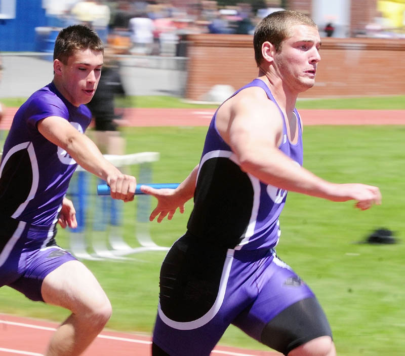 Waterville's Nick Stowe, left, hands off baton to teammate Nick Danner for final leg of 4x100 meters relay during the KVAC track meet on Monday May 27, 2013 in Bath.