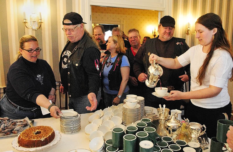 Staffer Kelsey Moody, right, pours tea for motorcyclists on Wednesday at Blaine House in Augusta. The annual United Bikers of Maine Blaine House Tea was kicked off when First Lady Ann LePage arrived as passenger on a motorcycle. There were remarks by her husband Gov. Paul LePage, other state officials and Sonny Bridges, founding father of United Bikers of Maine. There was a proclamation of May as Maine's Motorcycle Safety & Awareness Month.