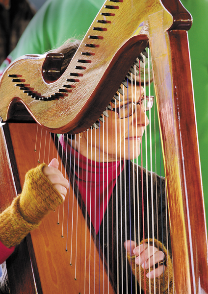 Harpist Deborah Ridlon performs at the Mill Park Farmers Market on Tuesday in Augusta. The market's summer hours are 2 to 6 p.m., Tuesdays through mid-November. In all, the market will have 16 vendors, according to market manager Emily Vellani. They'll have seedlings, produce, meat, eggs, honey, syrup, baked goods, ice cream, cheese and other items. The market will accept EBT or SNAP program payments.