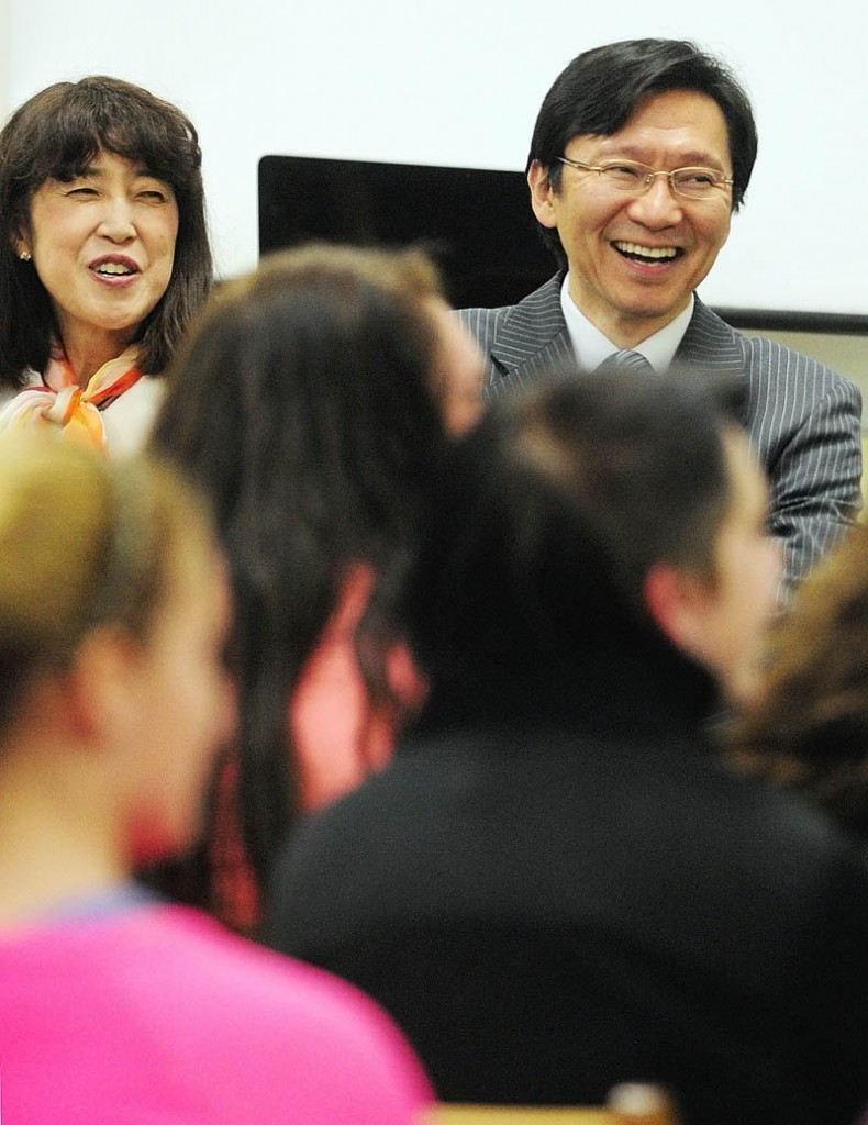 Akira Muto, Japanese Consul General for New England, right, and his wife, Misako, laugh and sing along as Japanese language teacher Naoto Kobayashi leads his students in a song Friday at Richmond Middle School. Muto, who is based in Boston, and his delelgation spent the day visiting Maine. They met with Gov. Paul LePage at the State House in Augusta and stopped at Hall-Dale Elementary School before the Richmond visit. There were visits to Bath and Portland scheduled for later in the day.