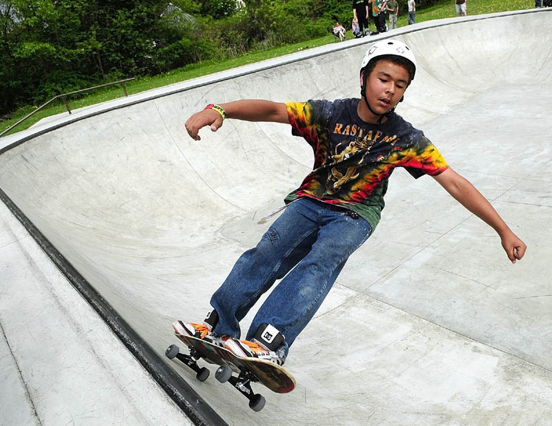"""Chris """"Flyin' Hawaiian"""" Thompson, of Windsor, rides in the bowl in the Augusta Skate Park during the Maine Sk8 Series Jam on Saturday, in Augusta. The park is in Williams playground near Bangor and Quimby Streets. The event was put on by the Gould Academy skateboarding program, and was the sixth of seven stops on the series' visits to skate parks across the state."""