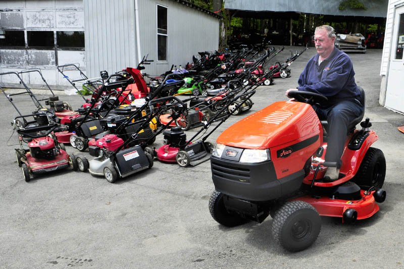 Owner Larry Mason drives a new lawn tractor past rows of push mowers in for repair on Tuesday at Mason's Lawnmower and Power Equipment in Augusta. He said that spring was the busiest time of year, as people bring in mowers, trimmers and tillers in for tune-ups or repairs. Mason said the business was started by his father almost 70 years ago. They repair and sell new and used snowblowers, mowers and other equipment on Haskell Street.